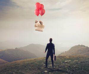 man gives piggy bank a tearful aerial goodbye
